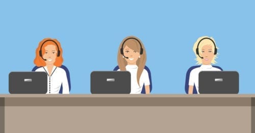 Three customer service agents sitting at a desk, wearing headsets and working on computers