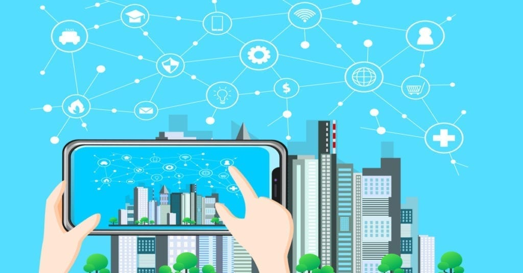 vector image of a hand click a mobile tablet with a city in the background with lots of icons against a blue sky