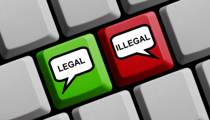 Computer Keyboard with speech bubble symbols on red and green key showing Legal or Illegal as an image for a piece on pocket listings