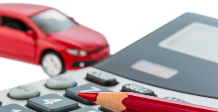 As an image for the 2019 irs mileage rate, a car and a red pen lying on a calculator. cost of gasoline, wear and insurance. car costs are not paid by commuter tax.