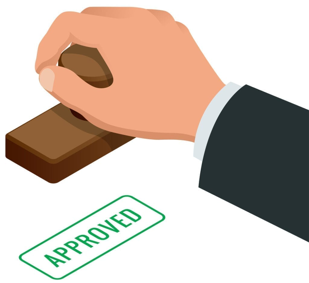 A white background being stamped with the word approved by a business person wearing a suit