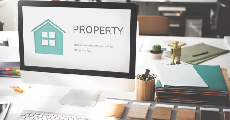 As a featured image for a piece on property management software companies, A photo with a graphical green house on it along with a little wooden robot