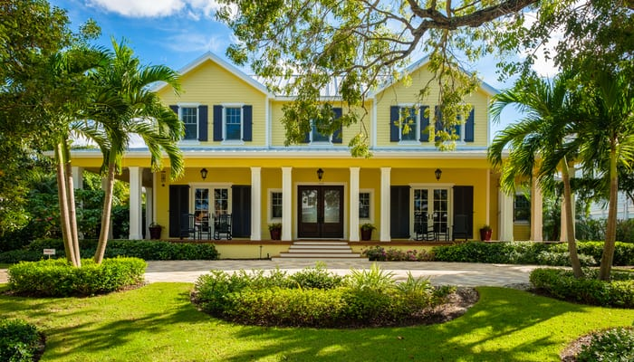 Classic architecture style home in the historic coastal gulf residential district of Old Naples.