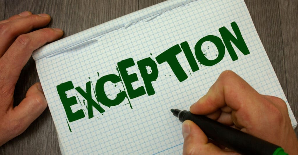 In green lettering, the word exception is spelled out with a marker onto a piece of white graph paper