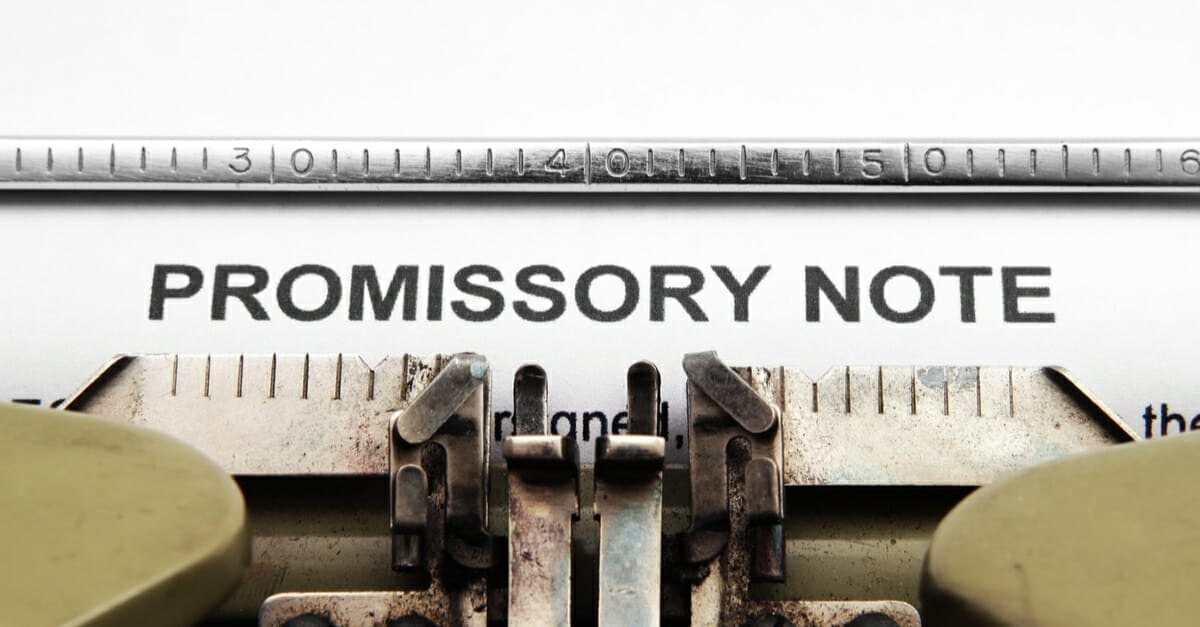 A typewriter window that has typed the words PROMISSORY NOTE on a piece of paper