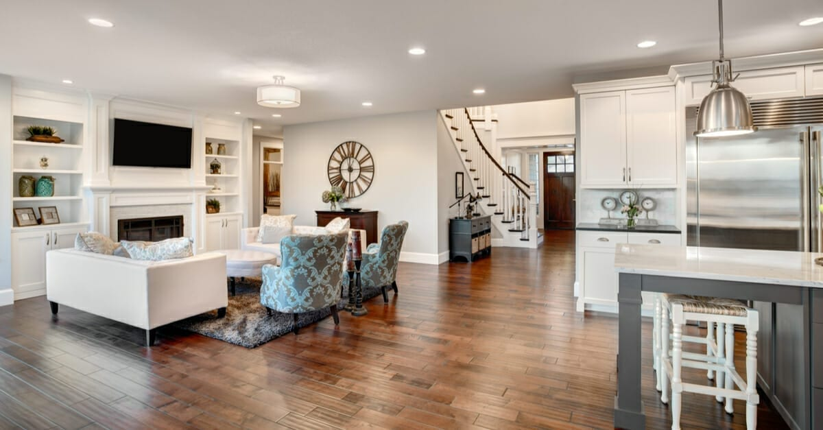A beautiful living room and kitchen with nice looking decor as the featured image for a piece on home staging