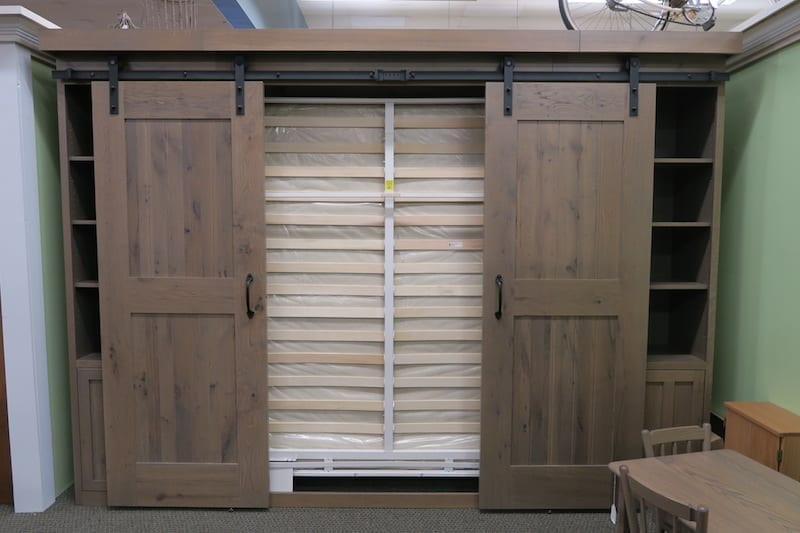 A Murphy Bed in a pair of sliding farm doors