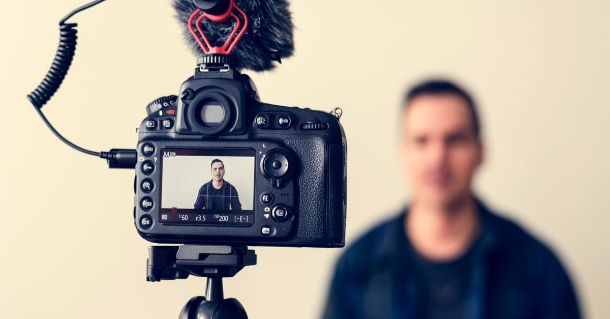 A man looking into a camera as the featured image for a piece on Vyral Marketing