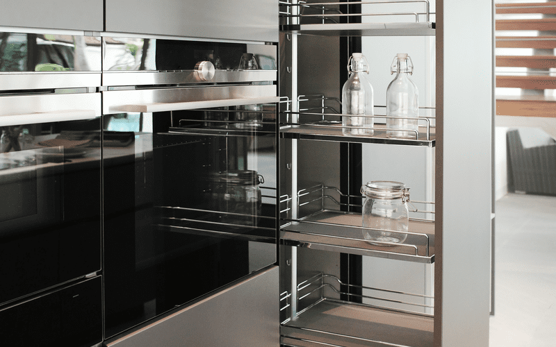 For a piece on tall kitchen cabinet dimensions, an open door with a slider
