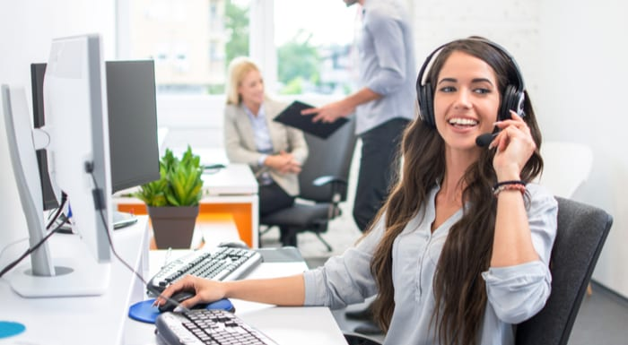 A real estate job description featuring an attractive telephone worker customer service operator woman working in the office