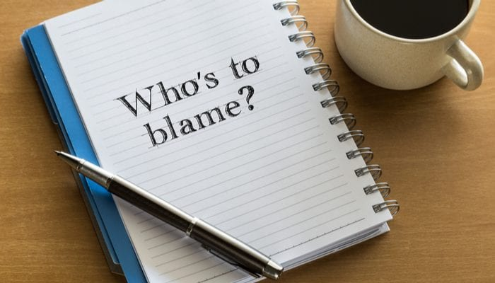 Who is to blame? responsiblity concept - handwriting on a notebook with cup of coffee