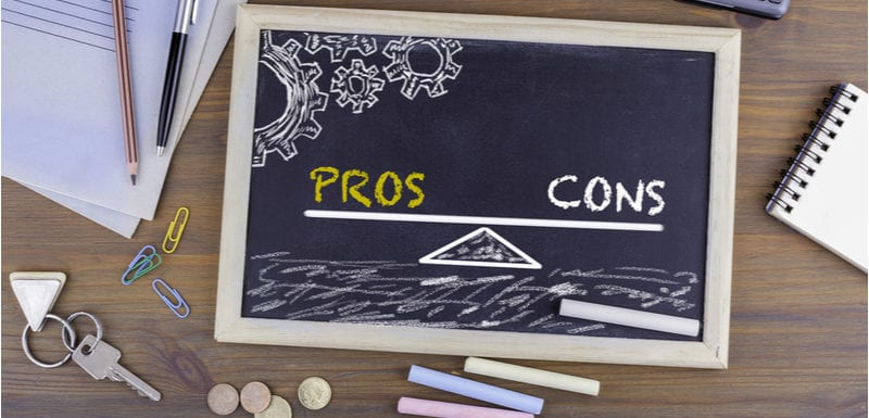 Pros and Cons Balance. Chalkboard on wooden office desk