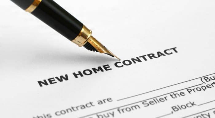 A fountain pen sits on the New Home Contract as the featured image for a piece on Contract for Deed