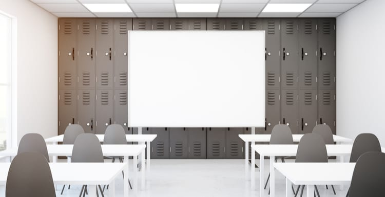 Contemporary grey classroom interior with empty whiteboard, desks and chairs. Mock up, 3D Rendering. School concept as the featured image for a piece on Oncourse Learning