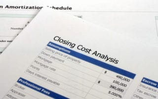 """A stack of papers with different loan docs, one says """"closing cost analysis"""" as the featured image for a piece on who pays closing costs"""