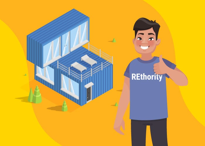 Guy in a REthority shirt giving a thumbs up and standing in front of a shipping container home