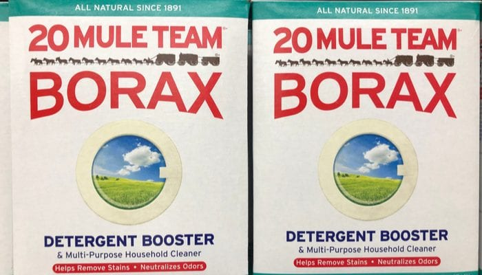 Boxes of 20 Mule Team Borax detergent boost cleaning supplies on sale at a retail store shelf