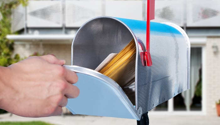 Close-up Of A Person Hand Checking Mailbox Outside The House to find off-market properties in your area