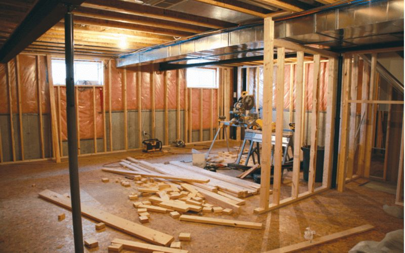 For a piece on how to finish a basement, a project midway through featuring studs being cut and installed