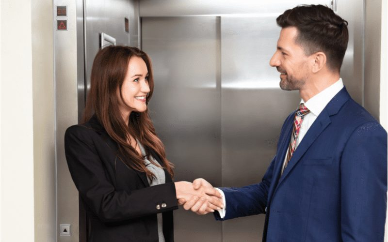 Elevator pitch with two people shaking hands in an introduction
