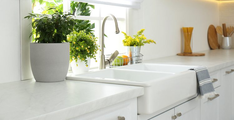 Featured image for a piece on kitchen sink dimensions featuring a 36x22 farmhouse style sink in white
