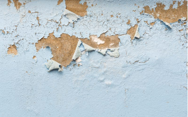 Concrete paint peeling off of a home's stucco exterior