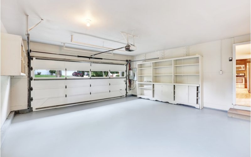 Concrete paint used in a standard size two car garage below shelves and next to a book case