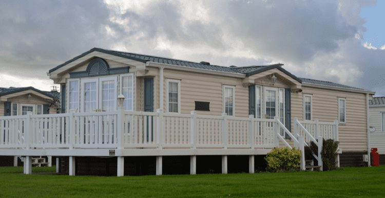 For a piece on mobile home remodels, such a home type with a large porch below a big cloud