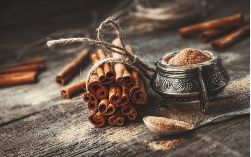 Cinnamon, a method to get rid of ants, sits on a table and in a fancy bowl