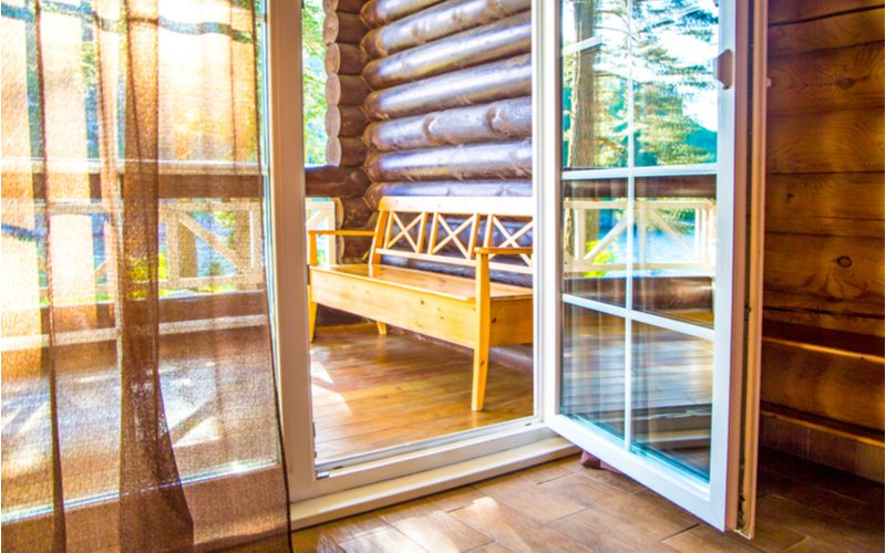 For a piece on French door sizes, such a door opens inward into a modern log cabin