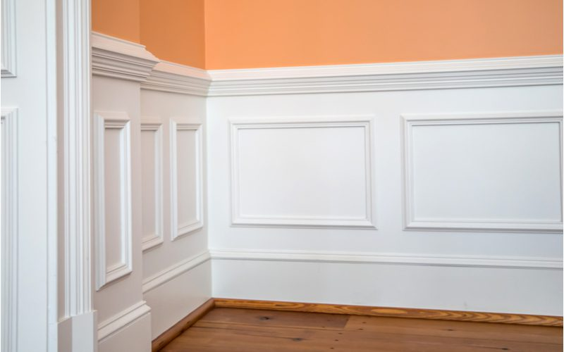 Wainscoting idea of a half-wall in the popular square pattern below a salmon-painted wall