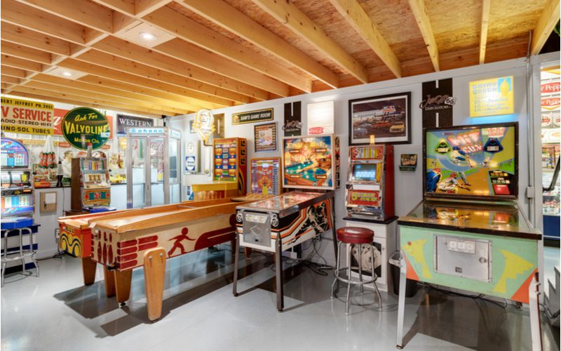 Idea for basement with a bunch of arcade games sitting in the open on a polished concrete floor
