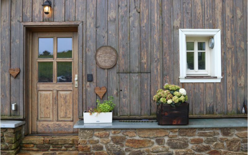 House entrance idea with a country-style door with a little window on the right to peep from