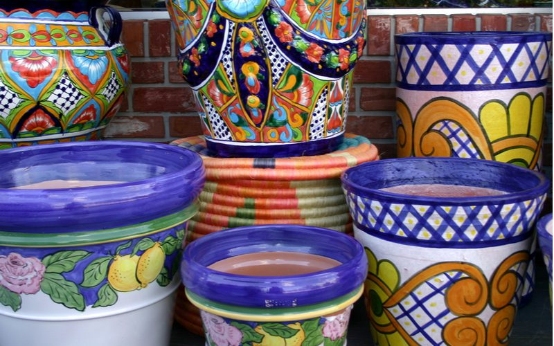 Talavera pottery pieces stacked on top of one another in a big pile