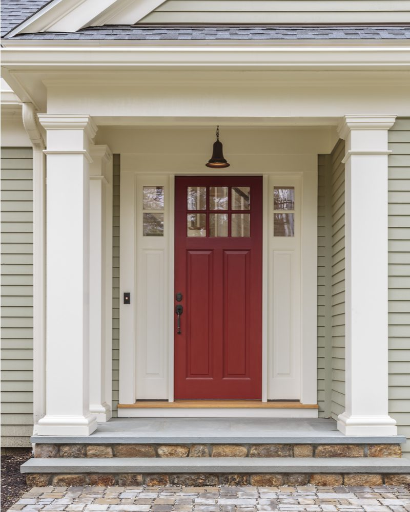 Example of a red door idea on a Colonial style modern house on the East Coast