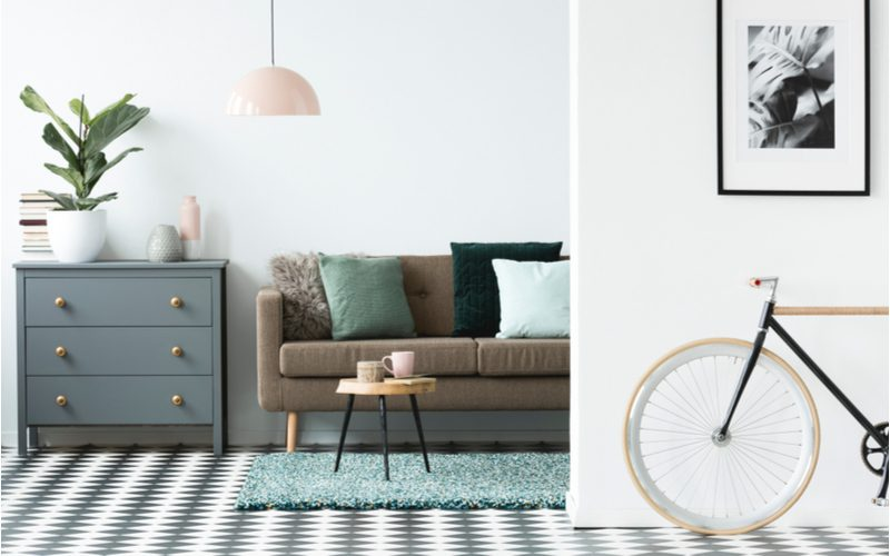 For an article on grey flooring living room ideas, a checkerboard floor in grey and white