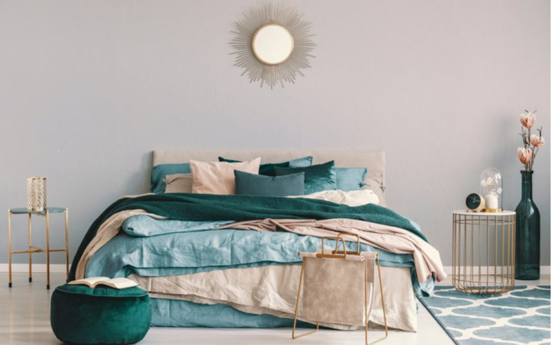 Teal bedroom ideas showing a very faint teal painted wall with such a color bedding