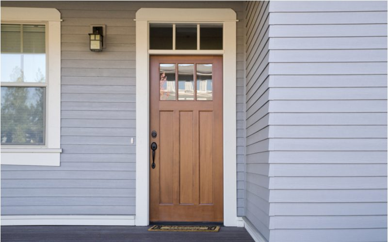 Brown front door on a gray house idea