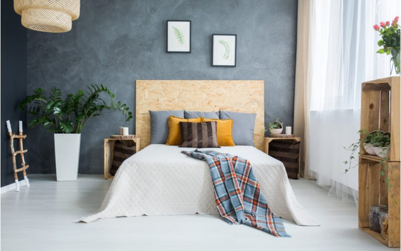 Piece on grey bedroom ideas featuring a rustic pallet and plywood furniture design with textured grey walls