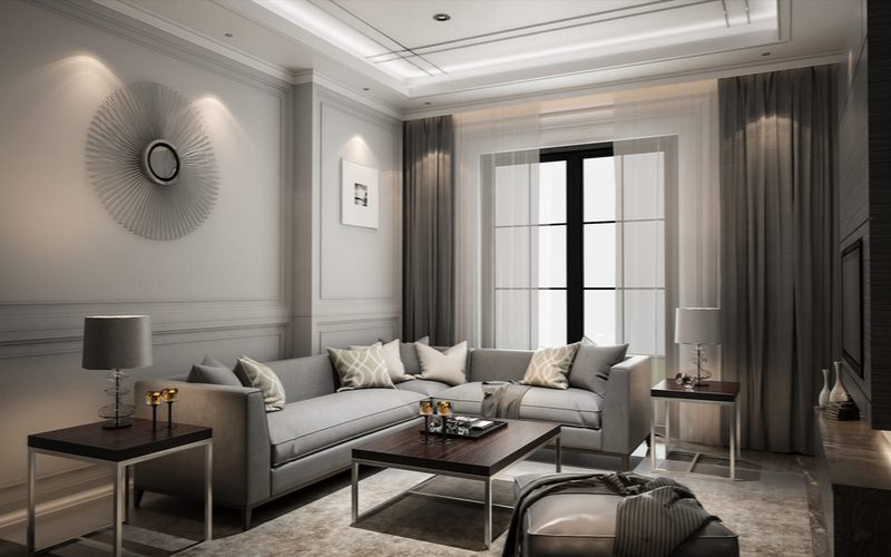 Classic-styled living room with gray walls and gray colored curtains